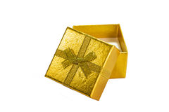 Golden gift box with golden ribbon on white background Royalty Free Stock Images