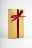 Golden gift box Stock Image
