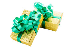 Golden gift box with green bow Stock Images