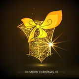 Golden gift box for Merry Christmas celebrations. Royalty Free Stock Photos