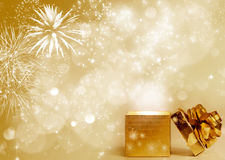 Golden gift box over holiday lights Stock Photos