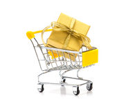 The golden gift box put in shopping cart on white background , n. Ew year celebration shopping concept Royalty Free Stock Photo