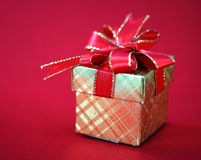 Golden gift box with a red bow Stock Photo