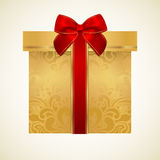 Golden gift box with red bow (ribbon). Present