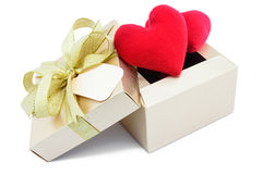 Golden gift box and red heart. Golden gift box and red heart on white background Royalty Free Stock Image