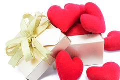 Golden gift box and red heart. Golden gift box and red heart on white background Stock Photography