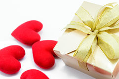 Golden gift box and red heart. Golden gift box and red heart on white background Stock Images