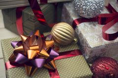 A gift box in a close up with other gift boxes and ornaments stock photo