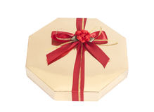 Golden gift box with red ribbon bow Royalty Free Stock Images