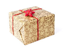 Golden gift box with red ribbon and star Stock Image
