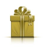 Golden gift box with ribbon and bow Stock Images