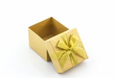 Golden gift box with ribbon bow. Stock Image