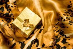 Golden gift box on silk Stock Photo