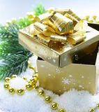Golden gift box in the snow, christmas still life Royalty Free Stock Photos