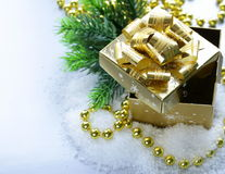 Golden gift box in the snow, christmas still life Stock Photo