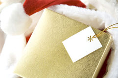 Golden gift box with tag Royalty Free Stock Images