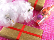 Golden gift box with white flowers and christmas balls in glass Stock Photo