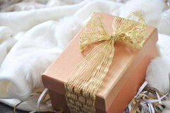 Golden Gift Box on White Scarf Background Royalty Free Stock Photo