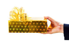 Golden gift box. In woman hand Stock Photography