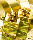 Golden gift boxes Stock Image