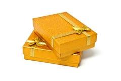 Golden gift boxes Stock Photos