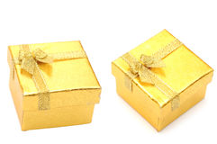 Golden gift boxes Stock Images