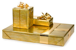 Golden gift boxes. On white background Royalty Free Stock Photography