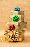 Golden gift boxes with ribbon bow shiny background Royalty Free Stock Photos