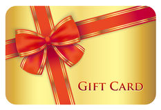 Golden gift card with red diagonal ribbon. Exclusive golden gift card with red diagonal ribbon Royalty Free Stock Photography