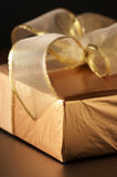 Golden gift close-up Royalty Free Stock Image