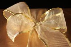Golden gift close-up Stock Photos