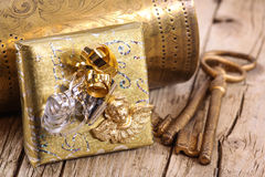 Golden gift with keys Stock Photography