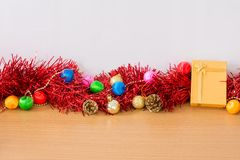 Golden gift with red ribbon on table for New Year and Christmas. Concept Royalty Free Stock Photo