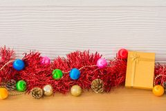 Golden gift with red ribbon on table for New Year and Christmas. Concept Stock Photo