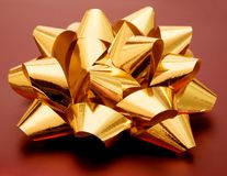 Golden gift ribbon Stock Images