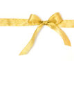 Golden gift ribbon and bow isolated over white Royalty Free Stock Photography