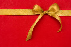 Golden gift ribbon and bow on red background. Some other you may also like Stock Image