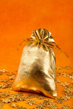 Golden gift sack and golden snowflakes Royalty Free Stock Photography