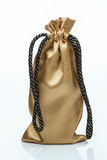 Golden gift sack Stock Photography