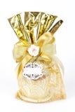 Golden gift sack of tea cup Stock Photo