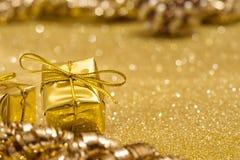 Golden gift. Santa  golden background, glitter bokeh Royalty Free Stock Image