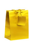 Golden gift shopping bag isolated on white Royalty Free Stock Image