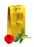 Golden gift shopping bag and red rose isolated on white Royalty Free Stock Photos
