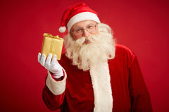Golden gift Stock Images