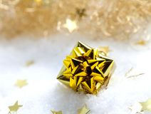 Golden gift in snow Stock Image