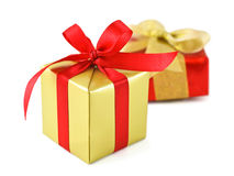 Golden gift wrapped present Stock Photography