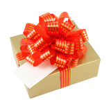 Golden gift wrapped present with red striped bow Stock Photos