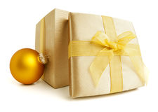 Golden giftbox and christmas bauble isolated Stock Photos