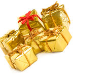Golden gifts Stock Images