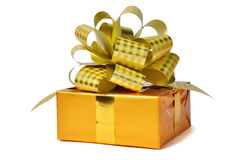 Golden gifts isolated over white Royalty Free Stock Photos